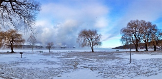 Lake effect snow clouds above Cayuga Lake at Stewart Park in Ithaca NY, on a bitterly cold day. Shot with iPhone 5s pano, edited in Apple Photos.