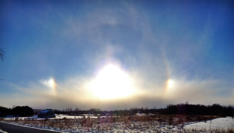 Sun dogs January 10, 2016, near Etna, NY. Shot with iPhone 5s and edited in Apple Photos.